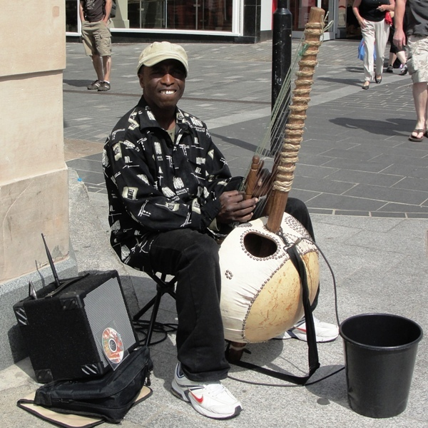 10.06.05   Liverpool Church Street musician (with kora, an African instrument) 016aaa 600x600